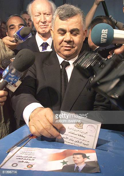 Syrian Prime Minister Mustafa Miro casts his presidential vote at a polling station in Damascus 10 July 2000 Bashar alAssad is the sole candidate to...