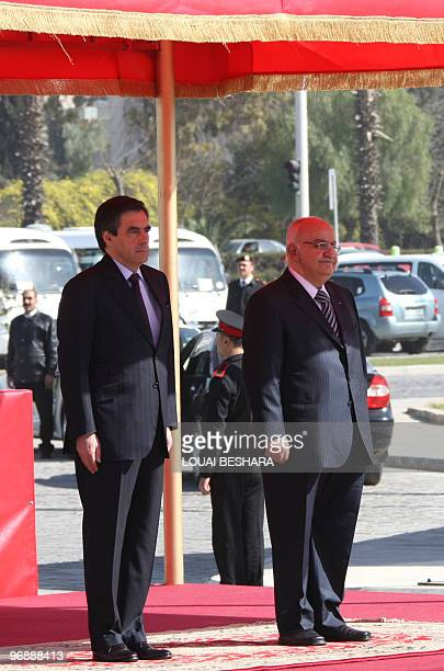 Syrian Prime Minister Naji alOtri and his French counterpart Francois Fillon listen to the national anthems of their countries during during a...