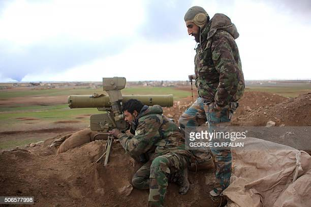 Syrian progovernment forces adjust a manportable antitank system as they hold a position in the Hatabat alBab area near town of AlBab in Aleppo's...