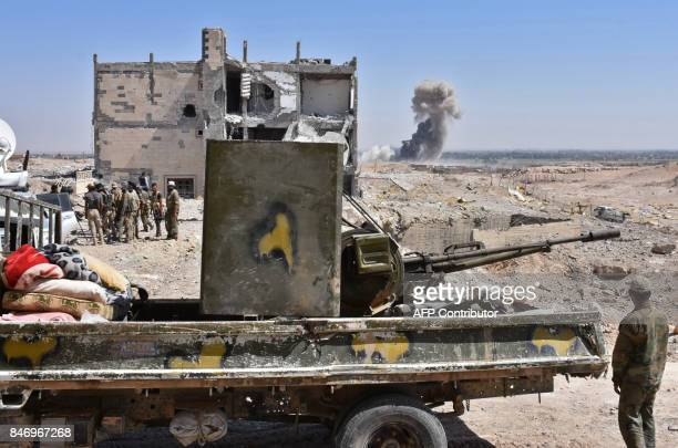 Syrian progovernment forces advance in the Jamiyet alRuwad neighbourhood on the northern outskirts of Deir Ezzor on September 14 during their ongoing...