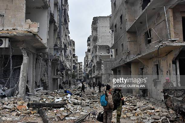 TOPSHOT Syrian progovernment forces advance in the Jisr alHaj neighbourhood during the ongoing military operation to retake remaining rebelheld areas...