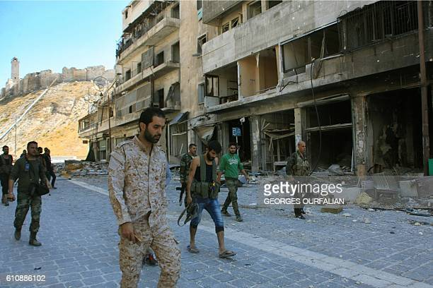 TOPSHOT Syrian progovernment forces are seen on September 28 2016 in the Farafira district northwest of Aleppo's historic citadel after Syria's army...