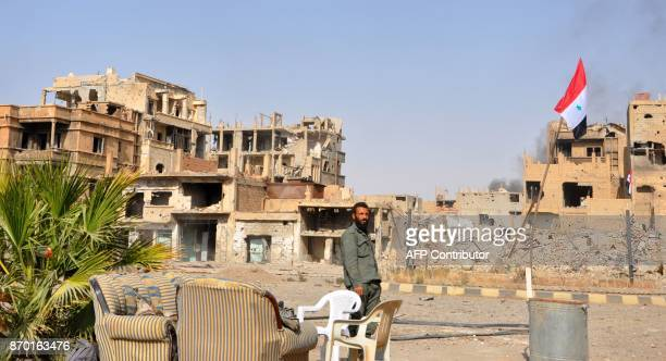 A Syrian progovernment forces member patrols in the eastern city of Deir Ezzor on November 4 2017 Syrian and allied forces converged on holdout...
