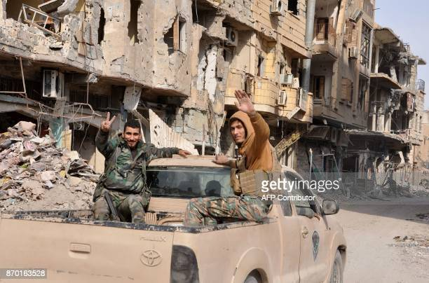 Syrian progovernment forces patrol in the eastern city of Deir Ezzor on November 4 2017 Syrian and allied forces converged on holdout Islamic State...