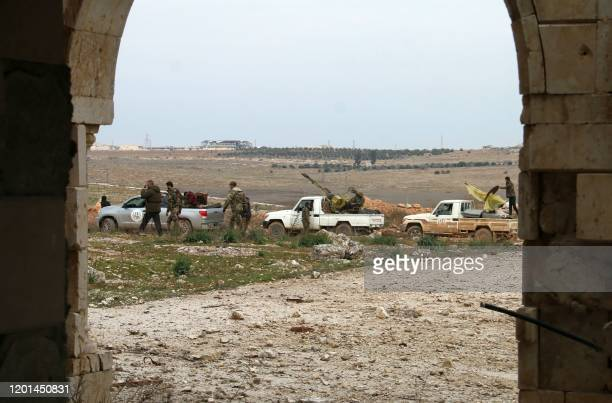 Syrian pro-government troops advance in the Tall Shwayhneh area towards the New Aleppo neighbourhood, west of Aleppo city, on February 16, 2020. -...
