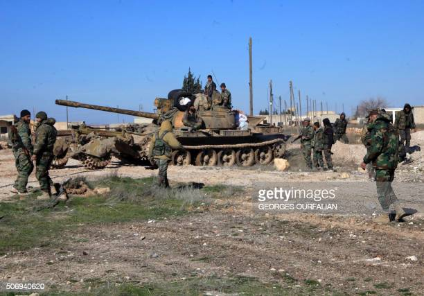 Syrian progovernment troops hold positions in the Syrian town of Ain alHanash near lBab in Aleppo's eastern countryside on January 26 2016 as regime...