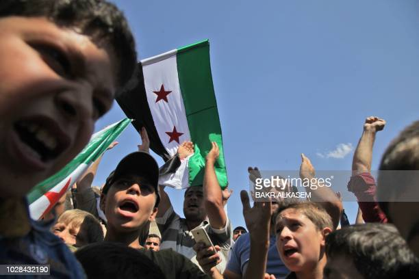 Syrian protesters demonstrate against the regime and its ally Russia in the rebelheld northeastern Aleppo province countryside on September 7 2018...