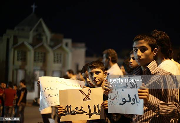 Syrian protesters gather to demand the release of Italian Jesuit priest Father Paolo Dall'Oglio in the northern city of Raqqa late on August 2 2013...