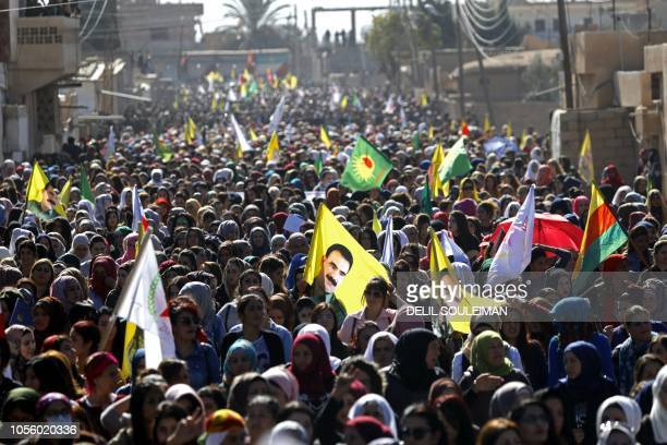 Syrian protesters mainly Kurds chant slogans during a demonstration in the town of alQahtaniyah in the Hasakeh province near the SyrianTurkish border...