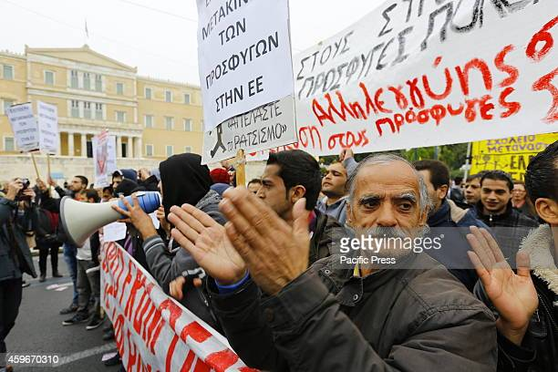 Syrian protesters shout slogans to the parliament during the General Strike protest march. The Syrian Refugees who camp outside the Greek Parliament...