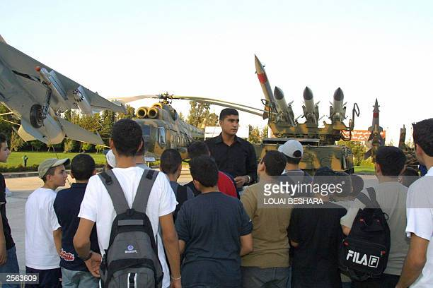 Syrian pupils from the city of Halab listen to their teacher as he stands in front of weapons used in the 1973 ArabIsraeli war at the '06 October...