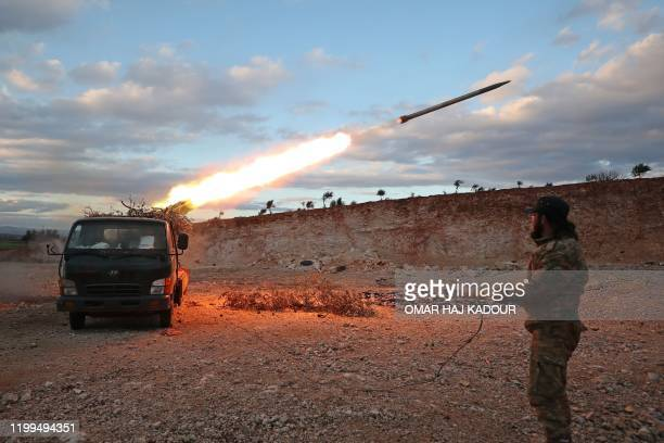 Syrian rebel fighter fires a rocket towards government forces in northwestern Syria on February 8, 2020. - Since December, government forces have...