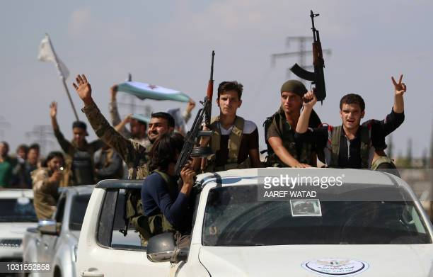 """Syrian rebel fighters from the recently-formed """"National Liberation Front"""" parade following military training at an unknown location in the northern..."""