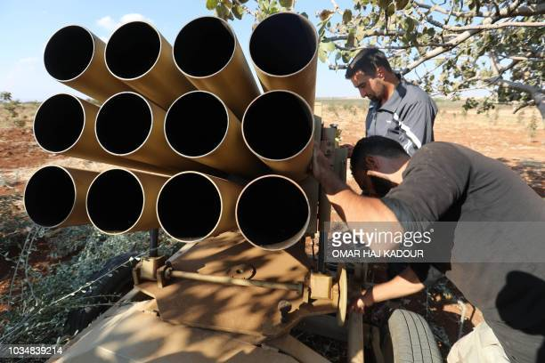 Syrian rebel fighters prepare their heavy artillery in the Syrian village of alZakat in the northern countryside of Hama province on September 17...