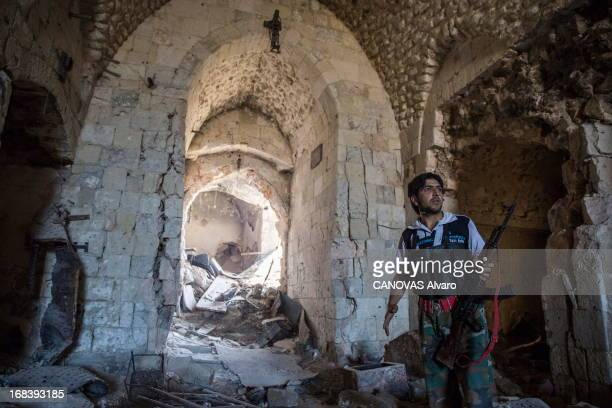 Syrian rebel hides in the souk on April 25 2013 in Aleppo Syria