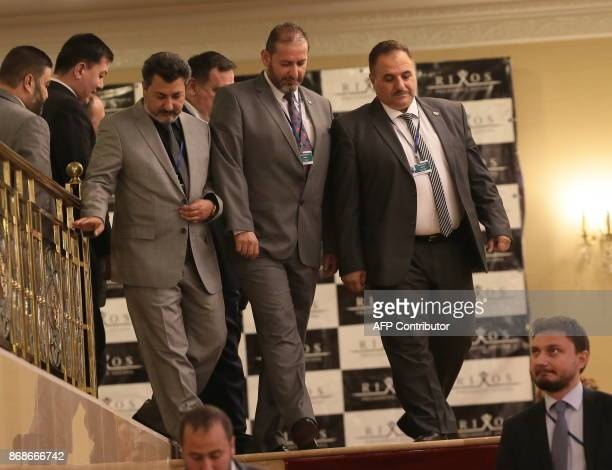 Syrian rebel representative General Ahmad Berri and other attendees walk during a seventh round of Syria peace talks in Astana on October 31 2017...