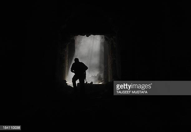 A Syrian rebel runs for cover during clashes with regime forces at the Umayyad Mosque in the old city of Aleppo hours before the Syrian army retook...