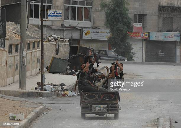 Syrian rebels head toward the frontline after three months of intense fighting between the government and rebels of the Free Syrian Army on October...