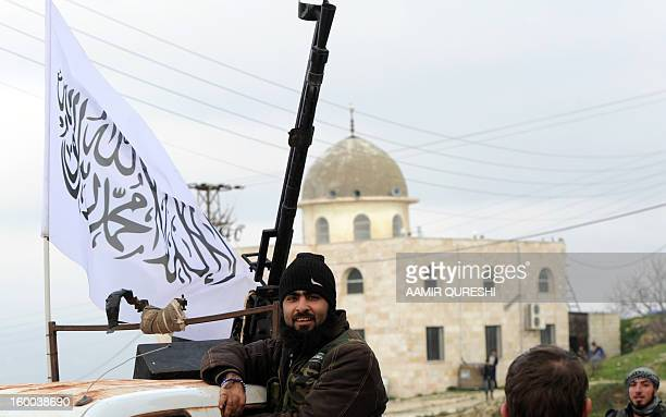 Syrian rebels take position in the northwestern Syrian town of Jisr alShughur on January 25 2013 More than 60000 people have been killed in violence...
