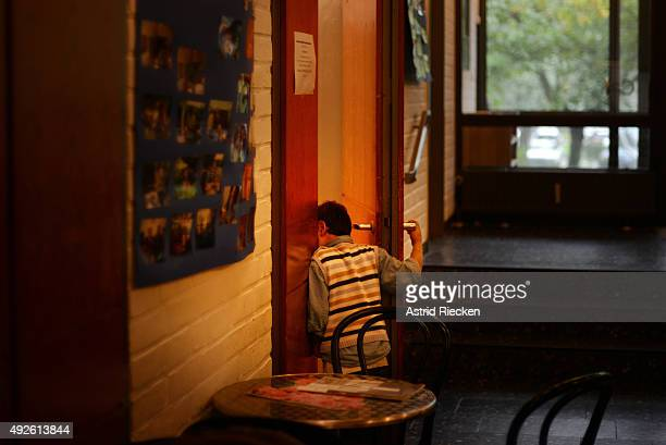 Syrian refugee Ali AlAwis peeks through the door at a church where his mother helps to prepare a breakfast for a pastors meeting October 8 2015 in...