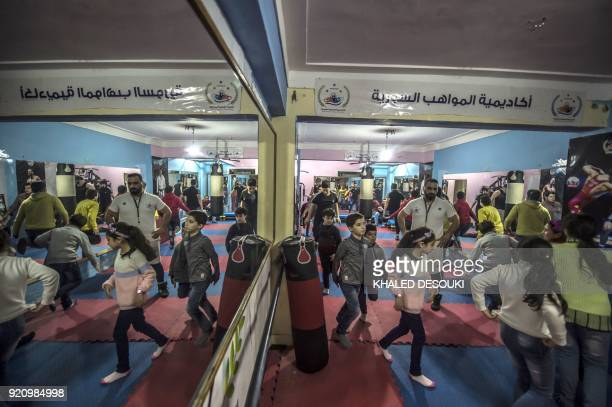 Syrian refugee Amir alAwad the founder of the Syrian Sports Academy teaches martial arts to youth at the academy in Egypt's second city of Alexandria...