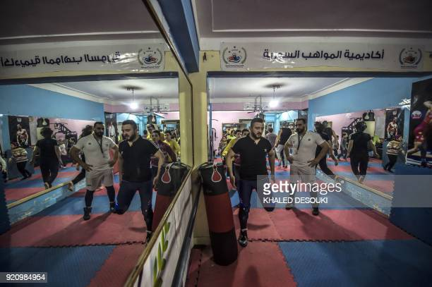 Syrian refugee Amir alAwad watches as Adel Bazmawi teaches martial arts to youth at the academy in Egypt's second city of Alexandria on January 4...