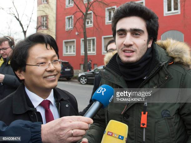 Syrian refugee Anas Modamani and his lawyer Chanjo Jun talk to the media on their way to the district court in Wuerzburg southern Germany on February...