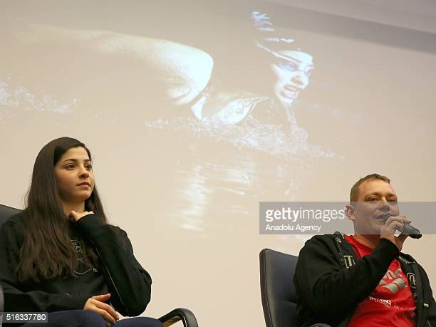 Syrian Refugee athlete Yusra Mardini and Trainer Sven Spanne attend a press conference in Berlin, Germany on March 18, 2016.