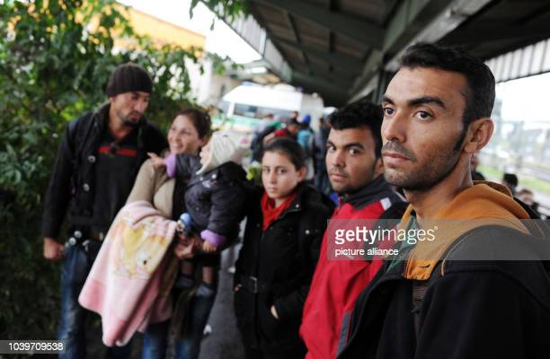 Syrian refugee Bezhad Ahmed and members of his family Ghandy Ahmed Sherin Melek Sipan Hewa Mano and Amin Ahmed stand in the train station after their...