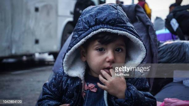 A Syrian refugee boy poses for a photograph at the Port of Piraeus 29 September 2018 Thousand migrants and refugees are scheduled to arrive at the...