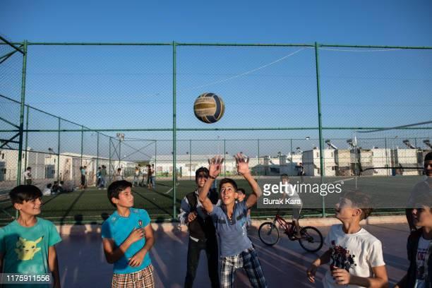 Syrian refugee boys play volleyball at the Kahramanmaras refugee camp's hospital on September 19 2019 in Kahramanmaras Turkey Turkey's president...