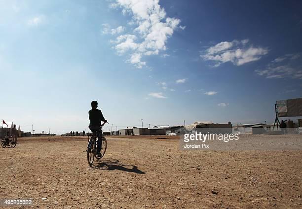 Syrian refugee child rides his bike in Zaatari camp on November 1 2015 in Mafraq Jordan European Commissioner for Humanitarian Aid And Crisis...