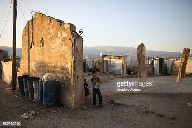 Syrian refugee child who has been forced to leave his home due to the ongoing war are seen inside the abandoned buildings in Beirut Lebanon on August...