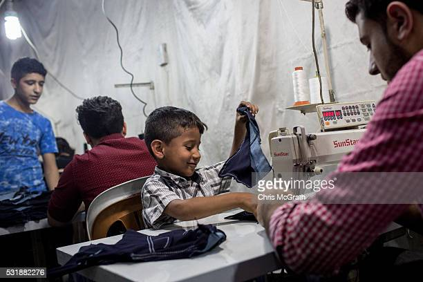 Syrian refugee child works in a Syrian owned clothing factory on May 17 2016 in Gaziantep Turkey Since fleeing the war and after the new EU Turkey...