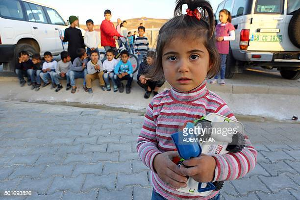 Syrian Refugee children are pictured at the refugee camp in Osmaniye on December 15 2015 Turkey is home to at least 22 million Syrian refugees after...