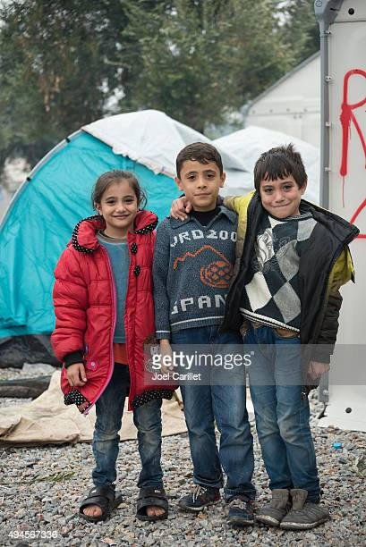 syrian refugee children arrived in europe - refugee camp stock pictures, royalty-free photos & images