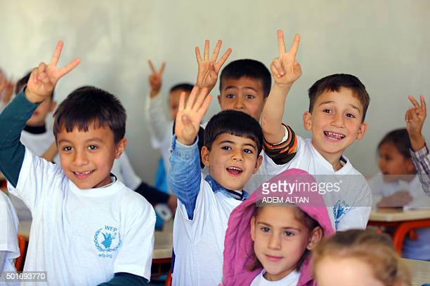 Syrian Refugee children attend classes at the refugee camp in Osmaniye on December 15 2015 Turkey is home to at least 22 million Syrian refugees...