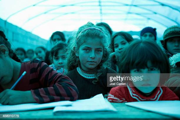 syrian refugee children in makeshift school - refugee camp stock pictures, royalty-free photos & images