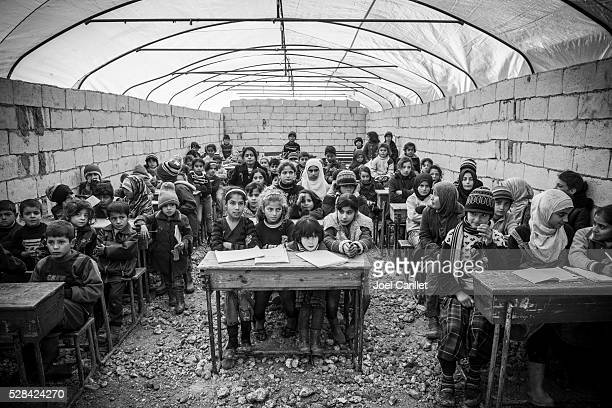 Syrian refugee children in school at IDP camp (Atmeh, Syria)