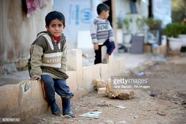 Syrian refugee children in the settlement camp where they live amongst an olive grove in Koura near Tripoli Lebanon