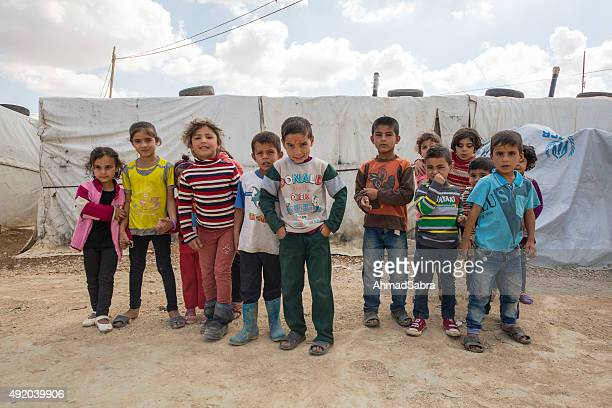 syrian refugee children - refugee camp stock pictures, royalty-free photos & images