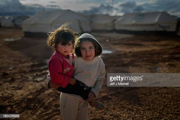 ZA'ATARI JORDAN JANUARY 31 Syrian refugee children play in the Za'atari refugee camp on January 31 2013 in Za'atari Jordan Record numbers of refugees...