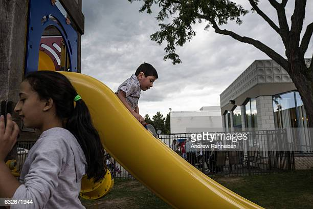 Syrian refugee children play on the playground after Friday prayers at the Unity Center on July 31 2015 in Bloomfield Hills Michigan Since the war...