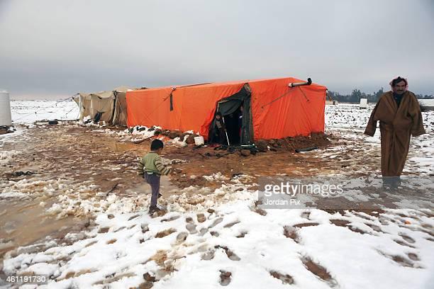 Syrian refugee children walk around their tent in one of the plenty small random camps around the biggest camp of Zaatari in northeast Jordan during...