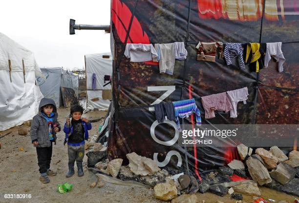 Syrian refugee children walk at an unofficial refugee camp in the village of Deir Zannoun in Lebanon's Bekaa valley on January 31 2017 / AFP / JOSEPH...