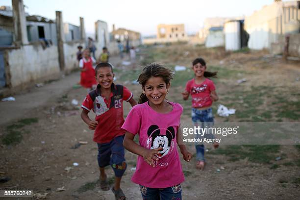 Syrian refugee children who have been forced to leave their homes due to the ongoing war are seen inside the abandoned buildings in Beirut Lebanon on...