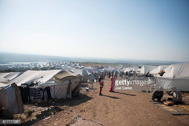 syrian refugee crisis - tents and people - refugee camp stock pictures, royalty-free photos & images