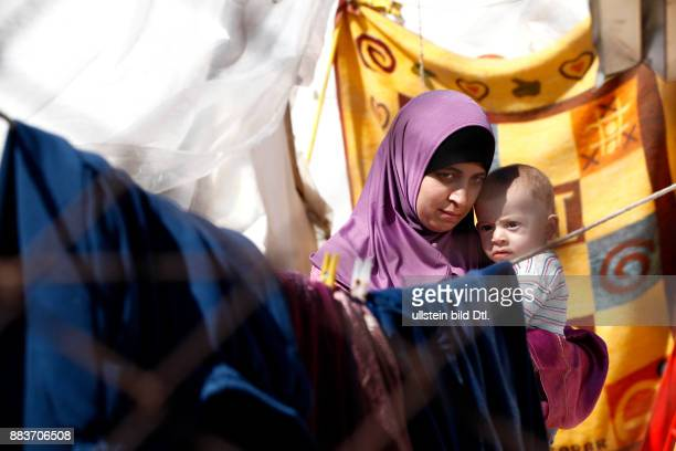 Syrian refugee delivered her child in a Turkish refugee camp She is worried about the hygiene and the lack of food