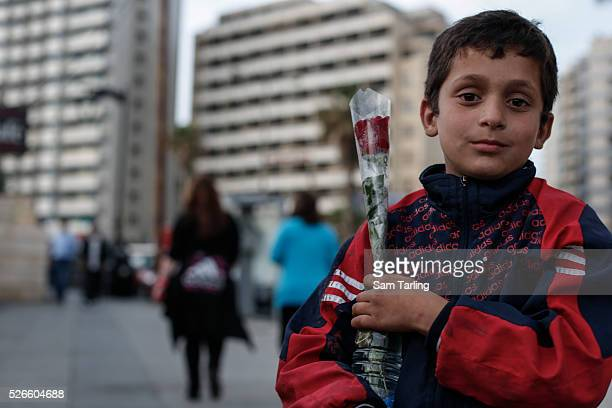 Syrian refugee Eissa from Hajjar alAsswad sells roses at the seafront in Beirut Lebanon on Thursday 17 April 2014 There are over 1 million Syrian...