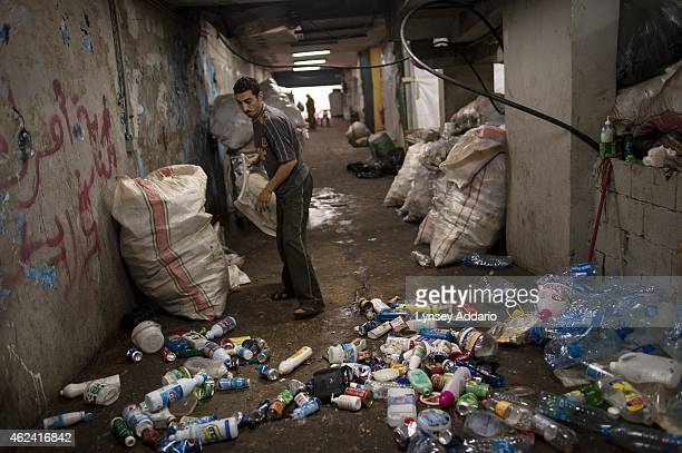Syrian refugee family who fled Homs in January 2013 lives in a garage underground where they collect sort and sell garbage to survive in Beirut March...
